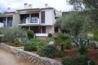 Apartments Palma & Pino - Apartment mit 1 Schlafzimmer und Gartenblick - Ferienwohnung Cres